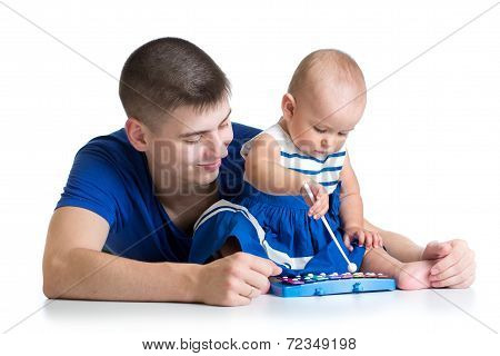Young Dad And Baby Girl Having Fun With Musical Toys