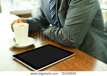 Businessman Having Coffee