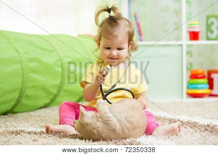 Kid Girl Playing Doctor With Kitten