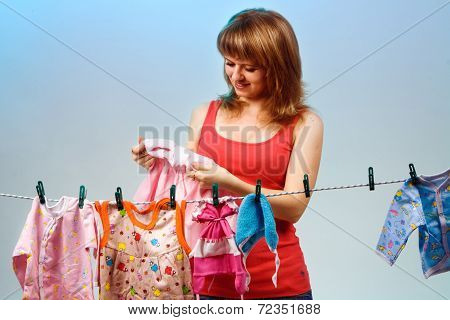 Woman With Baby Clothes