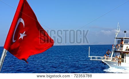 Turkish flag with a passenger boat