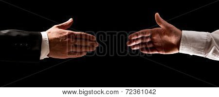 Two Men Reaching Out To Shake Hands