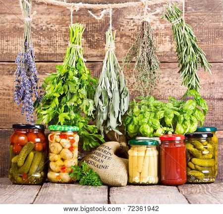 Various Fresh Herbs And Canned Food