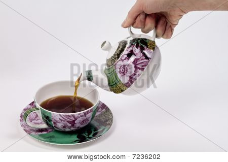 Pouring Tea Using Decorated Tea Set