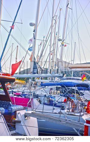 Yachts docked in marina
