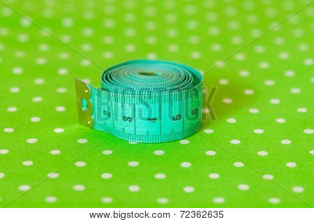 green centimeter on a green background