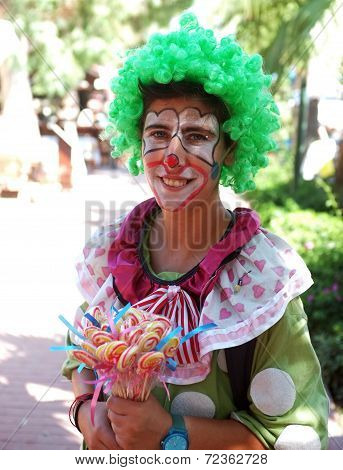 Female lolly seller in clown dress