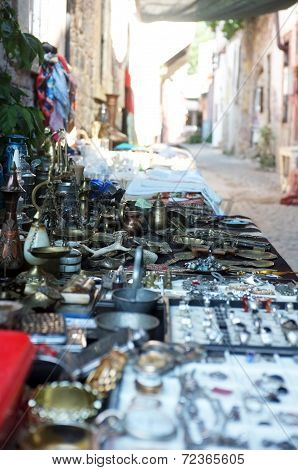 Antique goods on outdoor market stall
