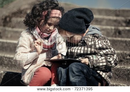 little girl and boy playing outdoor