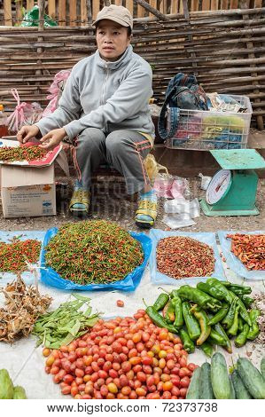 People Selling Food At Traditional Asian Market. Laos