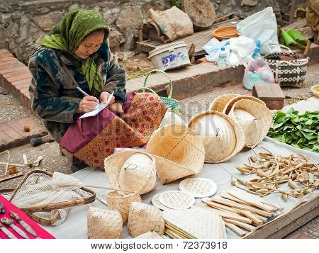 Woman Selling Traditional Asian Conical Hats. Laos