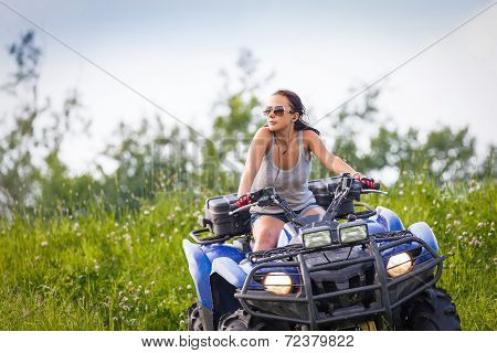 Elegant Woman Riding Extreme Quadrocycle