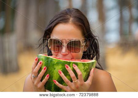 Woman On Beach Gets Sun Tan