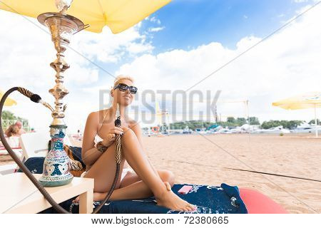 Woman With Hookah On Beach In Bikini