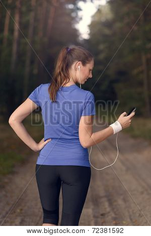 Attractive Happy Woman Standing Listening To Music