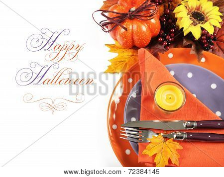 Happy Halloween Or Thanksgiving Party Table Place Setting With Autumn Fall Leaves, Pumpkin, Lit Cand