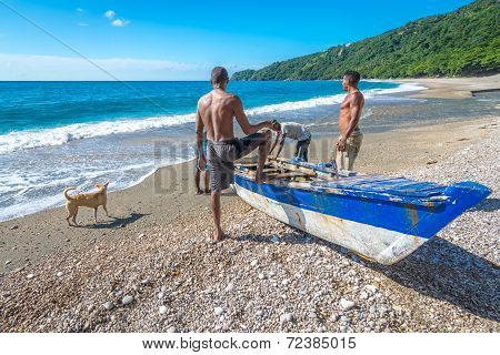 Unidentified local fishermen on Playa San Rafael Barahona Dominican Republic preparing their boat fo