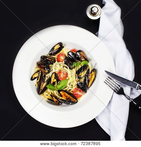 Gourmet Shellfish With Fresh Italian Pasta, Cherry Tomato And Herbs For A Tasty Seafood Meal Over Bl