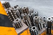 stock photo of turn-up  - Industrial drill bits stacked up on the shelf - JPG