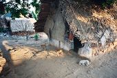 stock photo of mud-hut  - A poor slum hut found in India - JPG