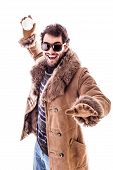image of snowball-fight  - a young man wearing a sheepskin coat isolated over a white background playing with a snowball - JPG