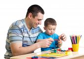 pic of molding clay  - Happy father and child boy play clay together - JPG
