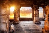 pic of vijayanagara  - Ancient temple with columns at sunset sky background in India - JPG