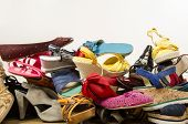pic of untidiness  - Untidy stack of shoes thrown on the ground - JPG