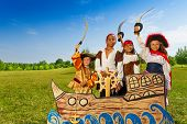 stock photo of pirate sword  - Four kids - JPG