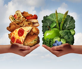 picture of vegetable food fruit  - Nutrition choice and diet decision concept and eating choices dilemma between healthy good fresh fruit and vegetables or greasy cholesterol rich fast food with two hands holding food trying to decide what to eat - JPG