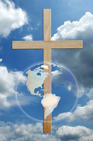 stock photo of christian cross  - The world and cross over sky - JPG