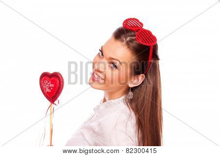 Beautiful brunette with heart shape glasses holding heart, on white background