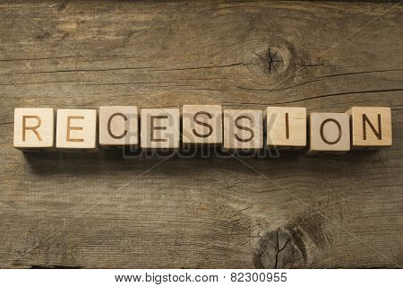 recession text on a wooden background