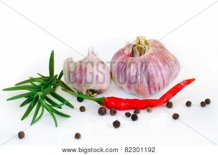 garlic, red pepper and rosemary on a white background