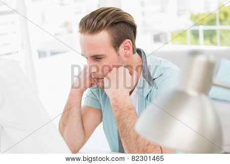 Focused businessman working with computer in his office