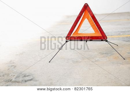 Close up on triangle warning sign in a car park
