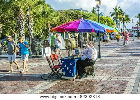 Fortune Teller With Tarot Cards Waits For Clients At Mallory Square