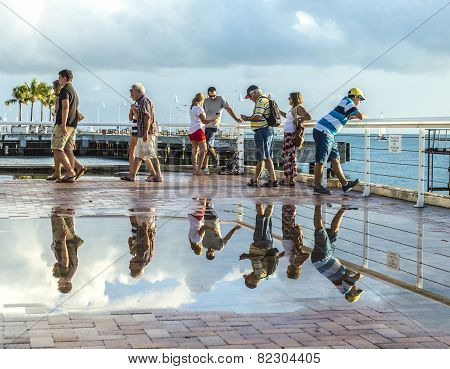 People Enjoy The Sunset Point At Mallory Square In Key Wes