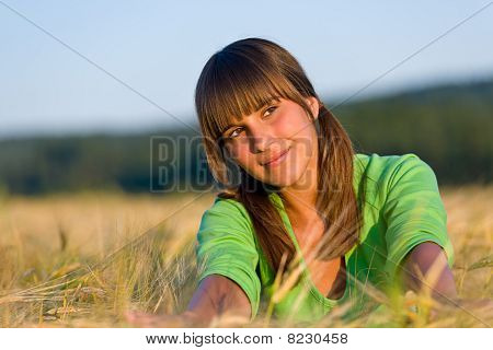 Portrait Of Happy Woman In Sunset Corn Field