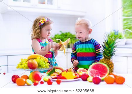 Kids Eating Fruit In A White Kitchen