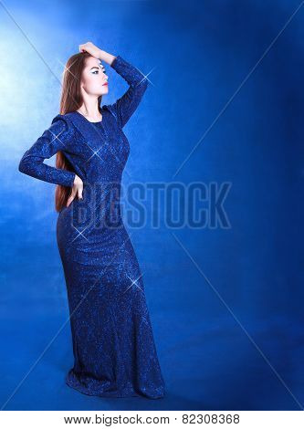 Full Length Portrait Of A Young Attractive Woman In A Shining Evening Dress
