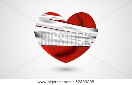 Red broken heart binding by bandage on shiny grey background for Valentine's Day.