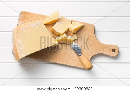 the parmesan cheese on cutting board