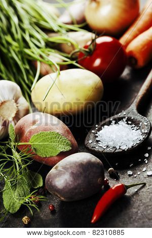 Fresh vegetables (potato, onion, carrot) ready for cooking. Health, vegetarian food or cooking concept. Fresh organic vegetables. Food background. Healthy food from garden