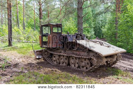 Old Skidder At The Forest In Summertime