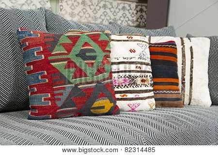 Herringbone sofa with traditional Turkish handmade colorful natural fabric pillows