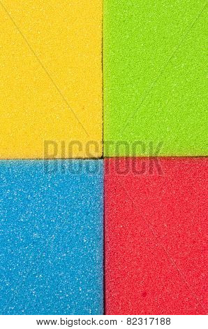 Closeup Of Four Colorful Kitchen Sponges