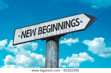 New Beginnings sign with sky background