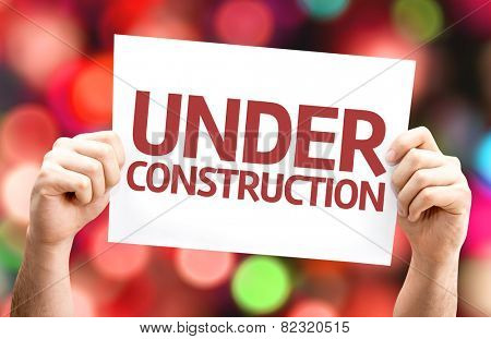 Under Construction card with colorful background with defocused lights