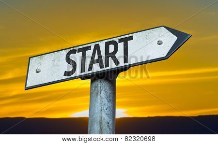 Start sign with a sunset background